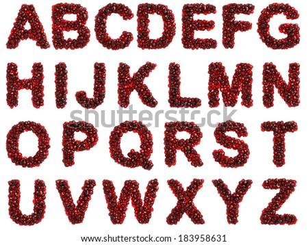 Pomegranate alphabet on white background - stock photo