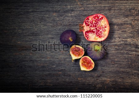 Pomegranate and fig - stock photo