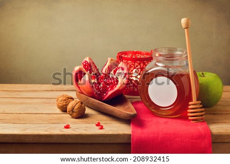Pomegranate and honey for Rosh Hashanah holiday. Jewish New Year. - stock photo