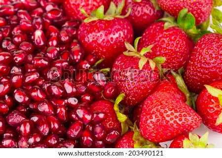 Pomegranate and strawberries. Isolated as a background.
