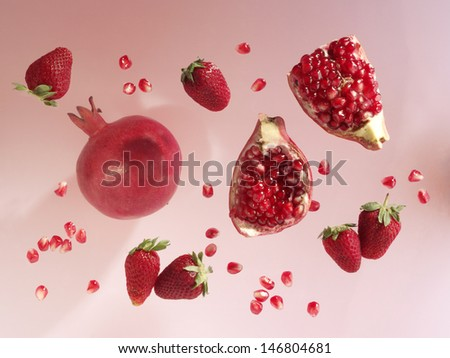 pomegranate and strawberry - stock photo