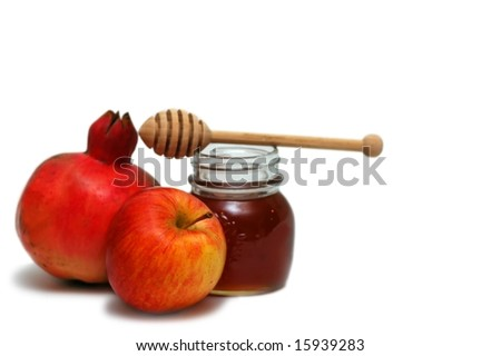 Pomegranate, apple and honey- jewish new year symbols - stock photo