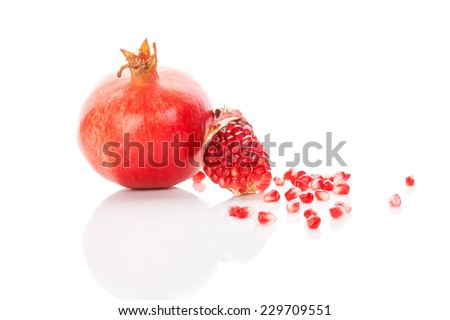Pomegranate background. Whole pomegranate and pomegranate core isolated on white background. Healthy fruit eating, super foods. - stock photo