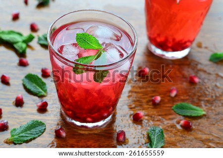 Pomegranate cold drink with mint and ice, selective focus  - stock photo
