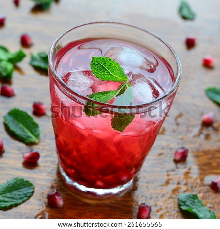 Pomegranate drink with mint and ice, selective focus  - stock photo
