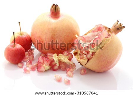 Pomegranate fruit and apple  is eaten as a sweet or sour and sweet pomegranate is a fruit that have health benefits. Pomegranate juice high in vitamin C. - stock photo