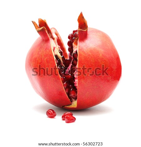 Pomegranate fruit and grains isolated on white background - stock photo