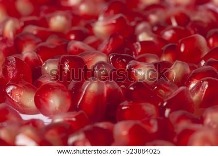 Pomegranate fruit and pomegranate seeds on white background