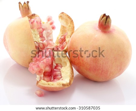 Pomegranate fruit is eaten as a sweet or sour and sweet pomegranate is a fruit that have health benefits. Pomegranate juice high in vitamin C. - stock photo
