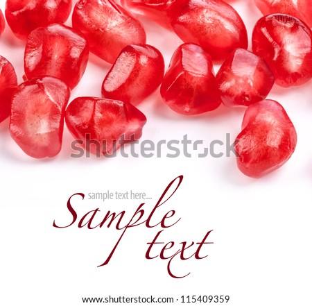 Pomegranate fruit seeds on white background - stock photo