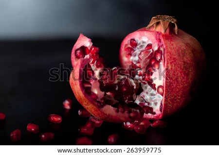 Pomegranate fruits on wooden table background, nature - stock photo