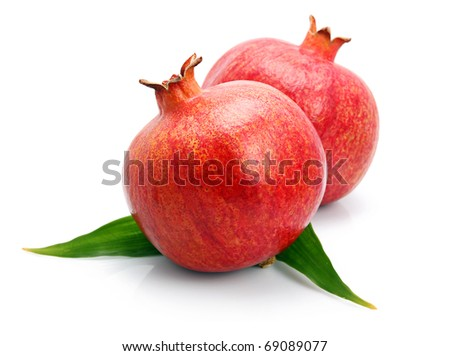 Pomegranate fruits with green leaf isolated on white background - stock photo