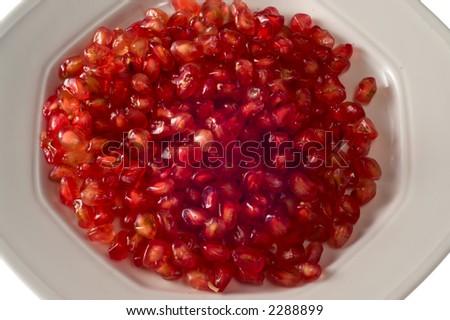 Pomegranate grains on dish - stock photo