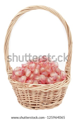Pomegranate in a basket - stock photo