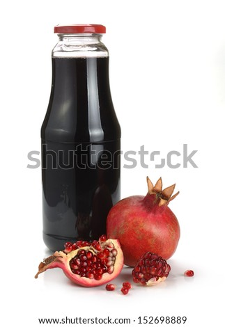 pomegranate juice and fruit on a white background