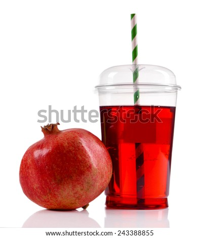 Pomegranate juice in fast food closed cup with tube and garnet isolated on white - stock photo