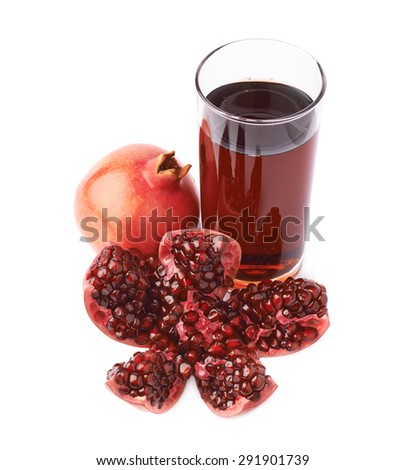 Pomegranate Punica granatum fruit next to the tall glass full of red juice, composition isolated over the white background - stock photo