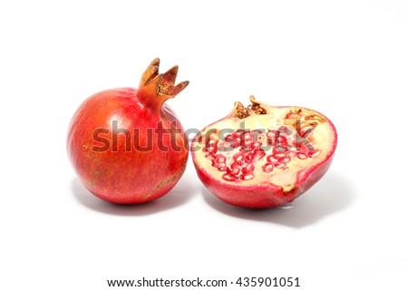 Pomegranate red fruit juicy ripe on white background - stock photo