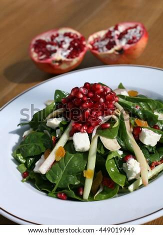 Pomegranate salad - stock photo