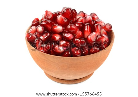 Pomegranate seeds in a wooden bowl - stock photo