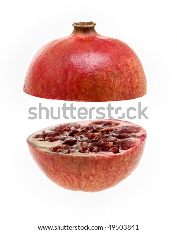 pomegranate sliced into two on a white background - stock photo
