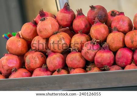 Pomegranate stand in Jerusalem market - stock photo