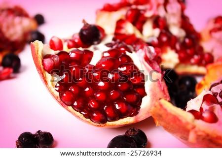 Pomegranate with blackcurrant - stock photo