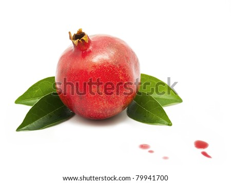 Pomegranate with juice drops - stock photo