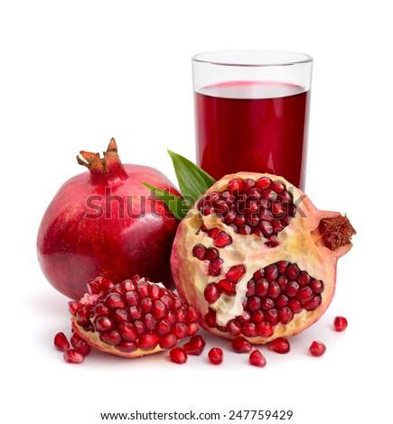 Pomegranates juice with fruit isolated on white background - stock photo
