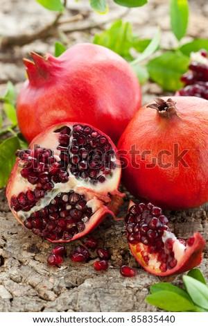 Pomegranates, whole and cut open - stock photo