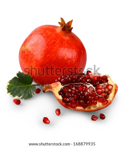 Pomegranates with fruit section isolated on white, close up