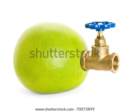 Pomelo with water tap isolated on white background
