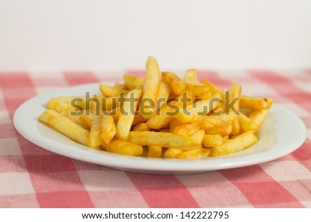 Pommes frites french fries on white plate