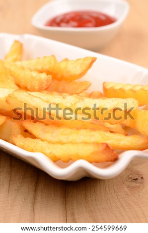 Pommes frites in a white bowl