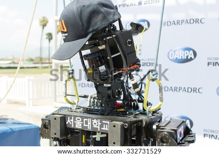 POMONA, CA - JUNE 6:  Team SNU's THORMANG robot at the DARPA Robotics Challenge in Pomona, CA on June 6, 2015. The Korean built robot finished the DRC challenge in 59 minutes for an 11th place finish. - stock photo