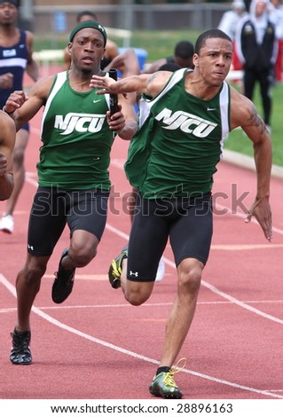 POMONA, NJ - APRIL 18: Ishmeal Robbins and Marc Robinson, compete during the CTC College Track Championships held at the Richard Stockton College of New Jersey April 18, 2009 in Pomona, NJ. - stock photo