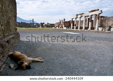 Pompeii is a ruined and partially buried Roman town-city near modern Naples in the Italian region of Campania, in the territory of the comune of Pompei. - stock photo