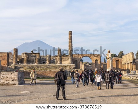 POMPEII, ITALY, DEC 26, 2015: people are walking through ruins of the historical city of pompeii. - stock photo