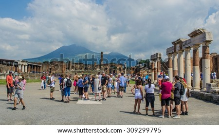POMPEII, ITALY, JUNE 28, 2014: people are walking through ruins of the historical city of pompeii. - stock photo