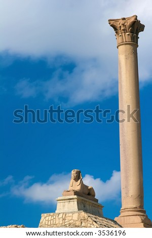 Pompey's Pillar in Alexandria Egypt with a sphinx - stock photo