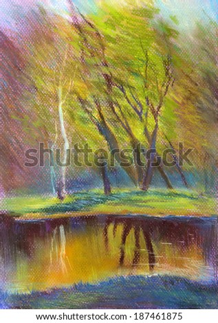 pond and autumn trees reflected in water