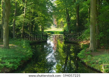 Pond in a landscape park on a sunny day in spring. - stock photo