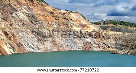Pond in a quarry - stock photo