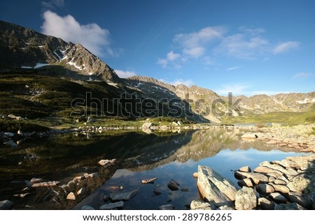 Pond in a valley in the Polish Tatra Mountains. - stock photo