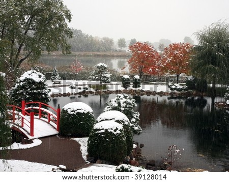 Pond in Japanese garden near Normandale college in Minnesota during snowfall - stock photo