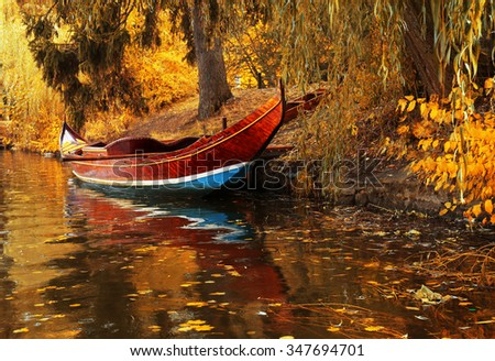 Pond in the autumn park - stock photo