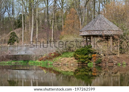 Pond scenery with bridge & gazebo from Brookside Gardens in Wheaton, Maryland (USA). HDR composite from multiple exposures. - stock photo