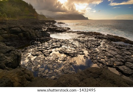 Pond, stone, hill & ocean on Kauai Hawaii. More with keyword Series001C. - stock photo