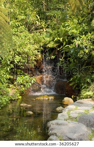 pond with a small waterfall - stock photo