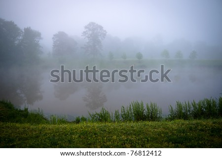 Pond with fog - stock photo
